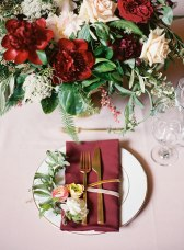 Contrasting gold and marsala creates dramatic table settings