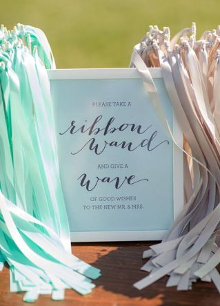 Add-a-dash-of-fun-and-flair-to-your-exit-with-ribbon-wands-waving-through-the-air-in-your-wedding-colors