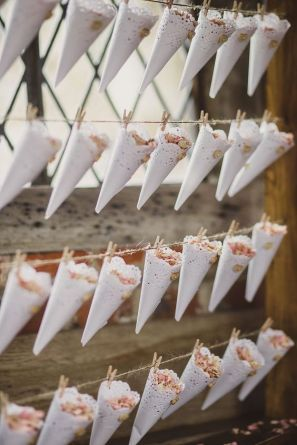 Lace-doily-confetti-cones-pegged-to-a-wooden-frame